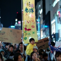 People in Tokyo join a rally to demand action on climate change.  | RYUSEI TAKAHASHI