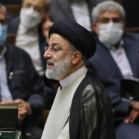 Iranian President Ebrahim Raisi speaks during his swearing in ceremony at the Iranian parliament in Tehran on Thursday.  | AFP-JIJI