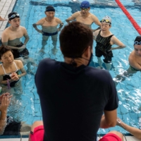 Hiromu Inada (fourth from left) and other students listen as their coach speaks during a training session in November.    AFP-JIJI