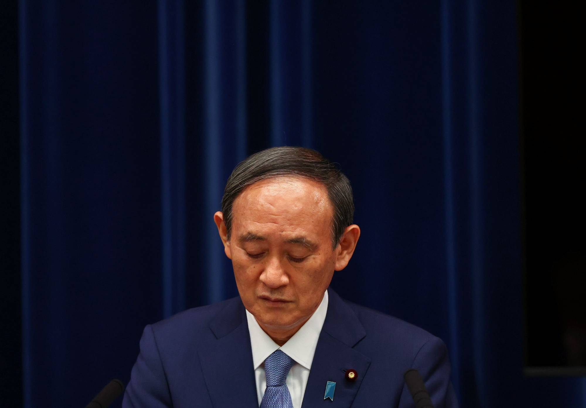 Prime Minister Yoshihide Suga attends a news conference on the response to the COVID-19 pandemic, in Tokyo on July 30.   REUTERS