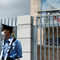 A policeman stands in front of the Polish Embassy in Tokyo on Tuesday. | REUTERS