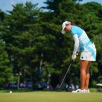 Japan's Mone Inami putts on the 18th green during the third round of the women's golf tournament at Kasumigaseki Country Club in Kawagoe, Saitama Prefecture.    AFP-JIJI