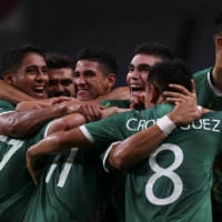 Mexico celebrates after going up 3-0 against Japan on Friday at Saitama Stadium.  | REUTERS