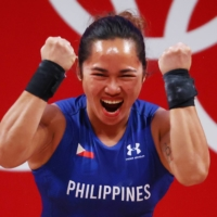 The Philippines bagged its first-ever gold medal this year at the Tokyo Games. And that medalist, weightlifter Hidilyn Diaz, is at odds with outgoing President Rodrigo Duterte. | REUTERS