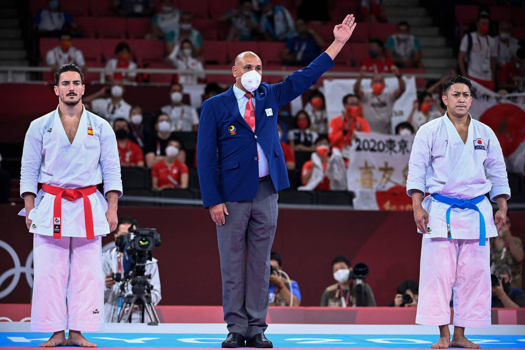 Japan's Ryo Kiyuna is awarded the gold medal over Spain's Damian Quintero after the final bout of the men's kata competition on Friday. | AFP-JIJI