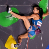 Akiyo Noguchi gets a leg up during the women's lead during competition of sport climbing.    REUTERS