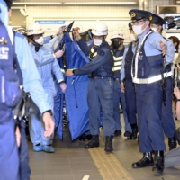 Knife attacker on Tokyo commuter train wanted to kill 'happy women'