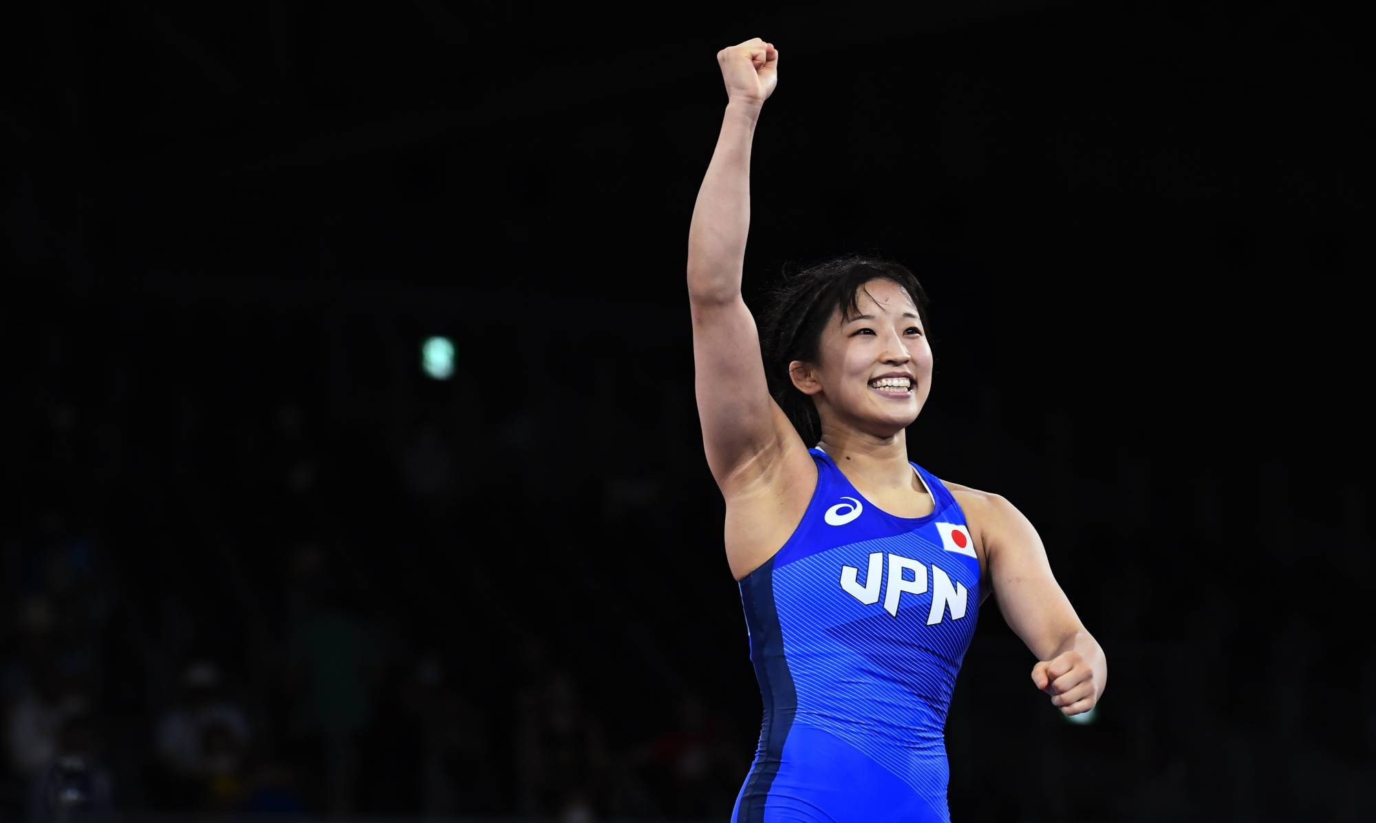 Yui Susaki celebrates after winning her semifinal in the women's freestyle wrestling 50 kg weight class on Friday.   REUTERS