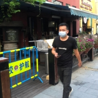 A man walks by McCawley's bar, which was closed after missing several rent payments, amid the global coronavirus disease (COVID-19) pandemic, in Shenzhen, Guangdong province, China, on July 25. | REUTERS