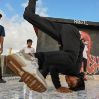 A student performs during a group class to learn breaking or 'b-boying' at a training session on the rooftop of a building in Dharavi slums in Mumbai on July 2. | AFP-JIJI