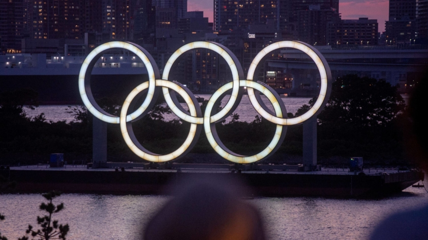 Olympic organizers slap COVID-19 rule-breakers with warnings and punishments