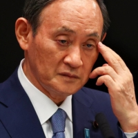 Prime Minister Yoshihide Suga attends a news conference on Japan's response to the coronavirus pandemic, at his official residence in Tokyo on July 30.   POOL / VIA REUTERS