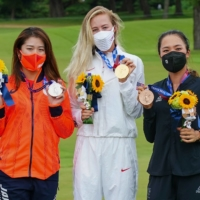 Mone Inami, Nelly Korda and Lydia Ko on the podium following the final round of the women's golf tournament.  | AFP-JIJI