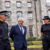 British Prime Minister Boris Johnson meets officers during a visit to the Scottish Police College near Kincardine on Wednesday.  | POOL / VIA REUTERS