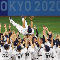 Team Japan celebrates after winning the gold medal game over the U.S. at Yokohama Stadium on Saturday.    REUTERS