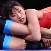 Yui Susaki of Japan wraps up Sun Yanan of China on her way to Olympic gold in the women's 50 kg division.  | REUTERS