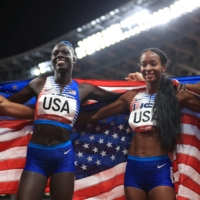 Team USA celebrates after winning gold in the women's 4x400 meter relay.   REUTERS