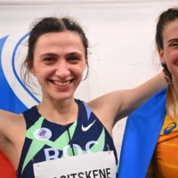 Gold medalist Maria Lasitskene of the Russian Olympic Committee poses with bronze medalist Yaroslava Mahuchikh of Ukraine following the women's high jump final.   REUTERS