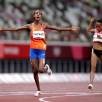 The Netherlands' Sifan Hassan reacts after winning gold in the women's 10,000 meter on Saturday night.   REUTERS