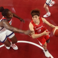 Japan's Rui Machida goes to the basket in a preliminary round match against the U.S. on July 30 at Saitama Super Arena.  | AFP-JIJI