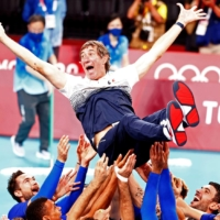France men's volleyball coach Laurent Tillie is thrown into the air by team members as they celebrate beating ROC and taking the gold medal.   REUTERS