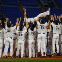 Japan's baseball team celebrates after beating the U.S. 2-0 to win gold at the 2020 Tokyo Olympics.   REUTERS