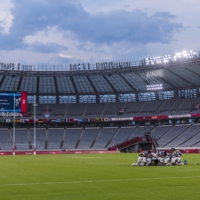The men's rugby sevens team from Fiji gathers on field amid the nearly empty stands after defeating New Zealand to win the gold medal at the postponed 2020 Tokyo Olympics in Tokyo on July 28.   HIROKO MASUIKE / THE NEW YORK TIMES
