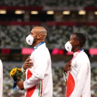 Gold medalists Lorenzo Patta, Lamont Marcell Jacobs, Eseosa Desalu and Filippo Tortu on the podium after the men's 4x100-meter relay final.  | REUTERS