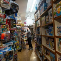 An employee walks in the aisles of Mary Arnold Toys, New York City's oldest toy store. | AFP-JIJI