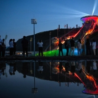 Journalists watch a light show at the National Ski Jumping Center for the Beijing 2022 Winter Olympics in Zhangjiakou, in northern China's Hebei province, in July.  | AFP-JIJI
