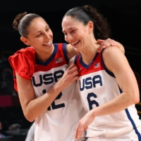U.S. players Sue Bird (right) and Diana Taurasi celebrate after winning the women's basketball final at the Tokyo Olympics in Saitama on Sunday. | REUTERS