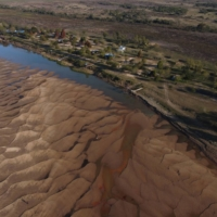 Dry land surrounds the Parana River as water levels recede in Rosario, Argentina, on June 24. | BLOOMBERG