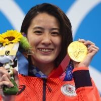 Swimmer Yui Ohashi wins gold in the women's 200-meter individual medley at the Tokyo Games on July 28.   REUTERS