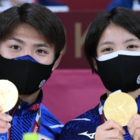 Japan's gold medal-winning judoka siblings Hifumi and Uta Abe pose with their medals at the Nippon Budokan in Tokyo on July 26. | AFP-JIJI