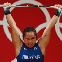 The Philippines' Hidilyn Diaz competes in the women's 55 kg Olympic weightlifting competition at the Tokyo International Forum on July 26.  | AFP-JIJI