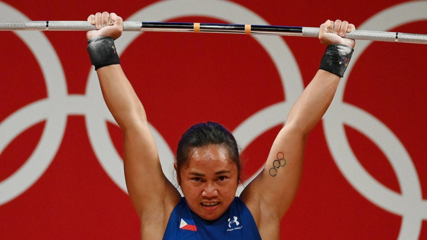 Tokyo Games marked by weightlifting firsts, but recent scandals cloud outlook