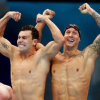 American swimmers Bowe Becker, Blake Pieroni and Caeleb Dressel celebrate after winning gold in the men's 4x100-meter freestyle relay.   REUTERS