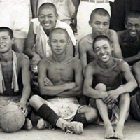 Shunji Okada (back row, second from right) participates in a school soccer club practice as a former team member during the summer after he graduated from the Okayama second middle school in March 1942.   COURTESY OF MASAKATSU TAKEYARI
