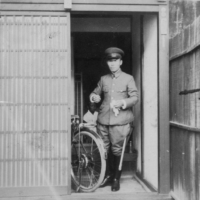 Motoichi Terao stands at the entrance of his home. He commuted to work at the Chugoku Military District Headquarters by bicycle every morning.   COURTESY OF OKIHARU TERAO