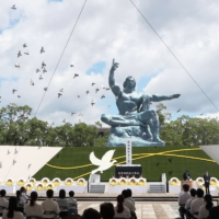 Doves are released at Peace Park in Nagasaki on Monday as the city marked the 76th anniversary of the atomic bombing by the United States.   POOL / VIA KYODO