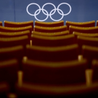 Rows of empty seats are seen at the Tatsumi Water Polo Center in Tokyo during the Olympics on Aug. 1. | REUTERS