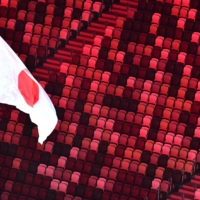 The Japanese national flag flutters near empty stands during the Tokyo Olympics opening ceremony at the National Stadium on July 23. | AFP-JIJI