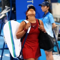 Japan's Naomi Osaka exits the court after losing her third-round match against Marketa Vondrousova of the Czech Republic. | REUTERS
