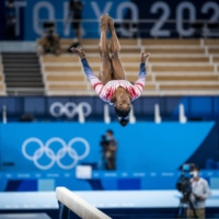 Simone Biles competes on balance beam after returning to the gymnastics competition. | DOUG MILLS / THE NEW YORK TIMES