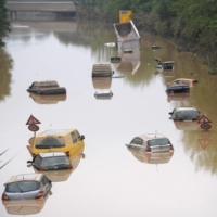 Submerged cars and other vehicles are seen on a federal highway in Erftstadt, western Germany, on July 17. | AFP-JIJI