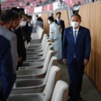 Prime Minister Yoshihide Suga attends the closing ceremony of the Olympics at the National Stadium on Sunday. | KYODO