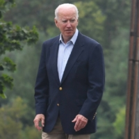 U.S. President Joe Biden commended Prime Minister Yoshihide Suga for hosting the 'successful' Tokyo Olympics during their phone talks on Tuesday. | AFP-JIJI