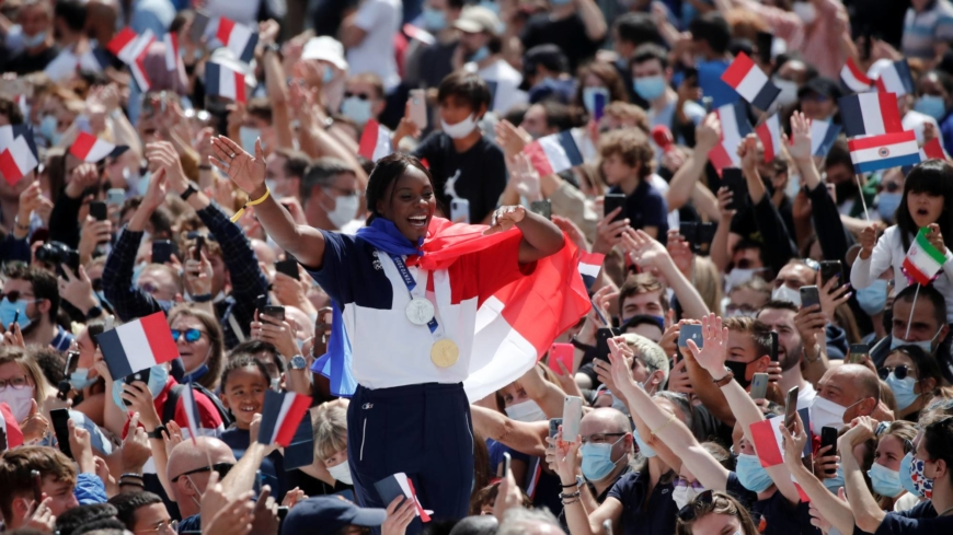 Flying the Olympic flag, Paris looks beyond COVID-19 for 2024 games
