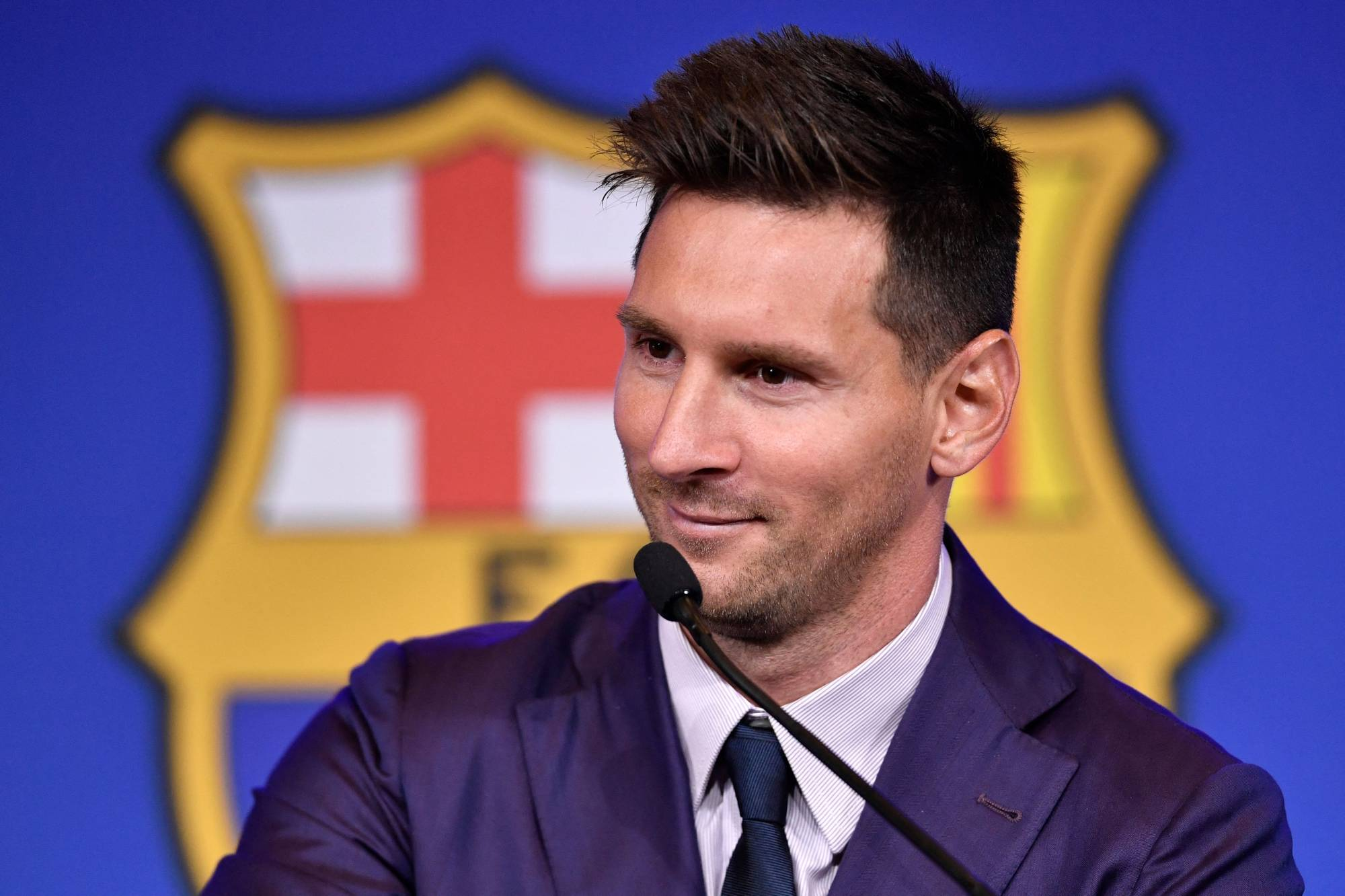 Barcelona's Argentinian forward Lionel Messi holds a news conference at the Camp Nou stadium in Barcelona on Sunday. Messi fought back tears as he confirmed he is leaving Barcelona, where he has played his entire career.   AFP-JIJI