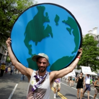 A protester at a climate march in Washington in 2017  | REUTERS